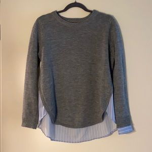 Attached blouse to sweater